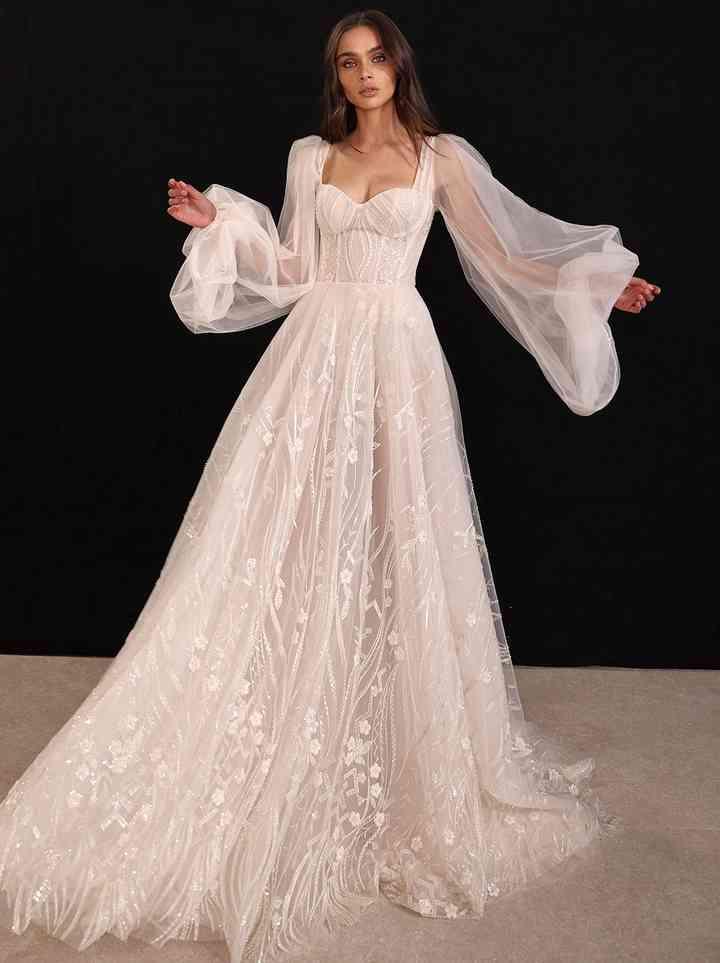 Vestido de novia corte en A manga larga